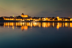 City of Torun in Poland, old town skyline by night from Vistula Stock Image