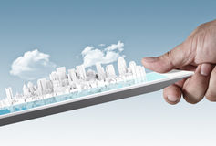 City on touch screen tablet as concept. Abstract virtual city on touch screen tablet as concept Royalty Free Stock Photos