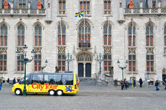 City tour bus in Bruges, Belgium Royalty Free Stock Image