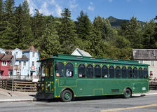 City Tour Bus. The green City tour bus takes tourists to explore the Royalty Free Stock Images