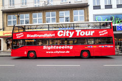 City tour bus. Red hop-on hop-off doubledecker bus in the city of Aachen, Germany Stock Photography