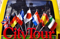 City tour bus for tourists detail with flags Royalty Free Stock Photo
