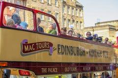City tour in Edinburgh in vintage bus. EDINBURGH - JULY27: a vintage double decker tour bus on the Royal Mile on July 27, 2011 in Edinburgh, Scotland. Edinburgh Royalty Free Stock Photos