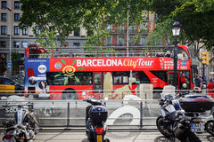 City tour excursion bus is staying parked at square   of Catalonia in Barcelona, Spain Stock Photo