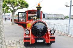 City tour by mini train on street of Geneva Switzerland Royalty Free Stock Photos