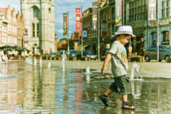 Young boy walking in the middle of the city street in Europe Stock Photos
