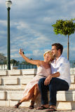 City tourism - couple in vacation on a bench Royalty Free Stock Image