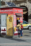 City tours office tickets in Prague. Tourist ask information on the city tours office in the city of Prague near the Old Town Square Stock Image