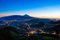 City or town with illumination after sunset Stock Image