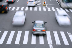 City traffic. Motion blur aspect of some cars in the traffic at a pedestrian crossing Royalty Free Stock Image