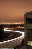 City traffic. A scene from salt lake city where cars and trucks speed past an office building royalty free stock image