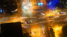 City Traffic. Big modern city busy traffic time lapse, Taipei, Taiwan. Bird's eye / static aerial view from above at night. Crossing streets, many cars + stock video footage