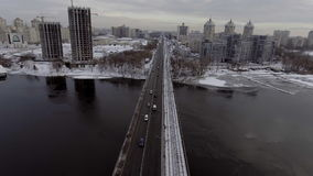 City Traffic on the bridge, it`s snowing. Shooting from the air, 4k video stock video