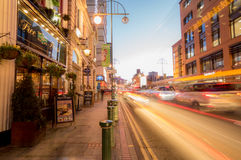 City traffic on Broad Street, Birmingham, at dusk Royalty Free Stock Image