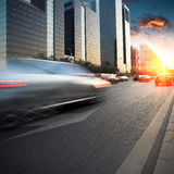 City traffic in dusk Stock Images