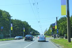 City traffic in Kharkiv on street decorated Ukrainian national flags stock photo