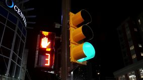 City traffic light turns from green to red stock video footage
