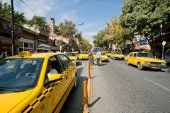 City traffic with lines of taxi cars of yellow color Royalty Free Stock Photos