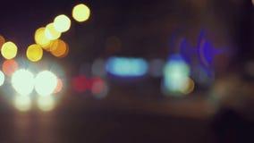 City traffic at night. Defocused shot. 4K. Resolution stock footage