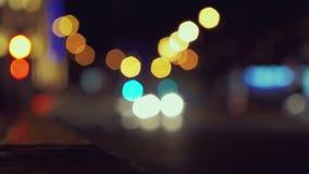 City traffic at night. Defocused shot. 4K. Resolution stock video footage