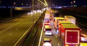 City traffic by night. City traffic on highway by night. Cars and trucks on road in loop time-lapse animation stock video footage