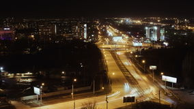 City Traffic At Night, Time Lapse. The cars are moving upon the road very fast stock footage