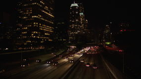 City traffic panning time lapse in downtown Los Angeles at night. 4K. Shot on the Red EPIC Digital Cinema Camera at 100fps stock footage