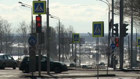 City traffic video on a sunny day. City traffic with passenger cars and traffic signs and lights video on a sunny day stock footage