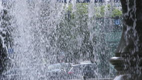 City Traffic and People Silhouette Behind Waterfall Fountain stock video