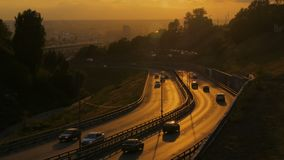 City traffic on the road at sunset stock video footage