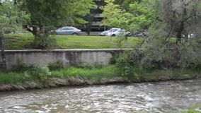 City traffic by a stream stock video footage