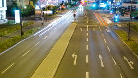 City traffic time-lapse at night. The fast pace and energy consumption of our society shown in a night traffic time-lapse, which can be used as a seamless loop stock footage