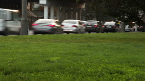 City traffic timelapse scene with green grass.  stock video
