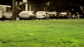 City traffic timelapse scene with green grass.  stock footage