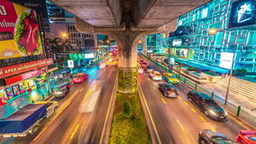 City traffic under the bridge of the highway in night Bangkok, Thailand. November, 2016. 4K TimeLapse stock video footage