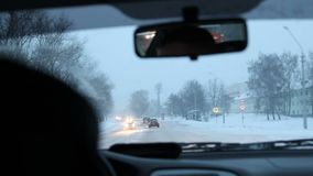 City traffic in winter in morning. City traffic in winter through the window stock video footage
