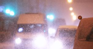 City Traffic In Winter Snowy Snowstorm Evening Or Night Time.  stock video footage