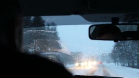City traffic in winter in morning. City traffic in winter through the window stock footage