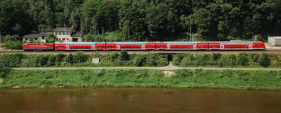 City train. Red city train over river Stock Photos