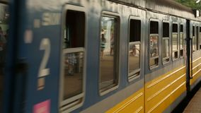 City train arriving to station and stopping, doors opening, public transport. Stock footage stock footage