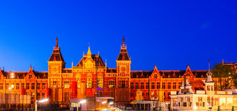 City Train Station at Night, Amsterdam, Holland Royalty Free Stock Photo