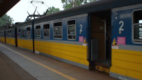 City train waiting for passengers at railway station, suburban transportation. Stock footage stock video footage