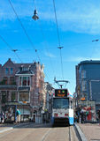 City tram Amsterdam. Tram stop in Leidsestraat street among people, in the centre of Amsterdam city Royalty Free Stock Photography