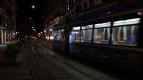 City tram at night Maximilianstrasse, Munich, Germany stock video footage
