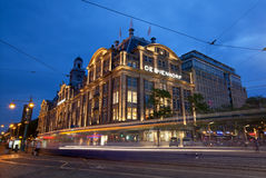 City Tram Passing by De Bijenkorf Store in Dam Square of Amsterdam Stock Photos
