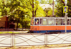 City tram on a street of Taganrog, Russia. May 23, 2017: The red tram on the move is on a straight stretch of road in the old town Royalty Free Stock Images