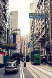 City trams in Hong Kong. HONG KONG, CHINA - MAY 19, 2014: City trams with double deckers and city buildings on may 19, 2014 in Hong Kong Stock Photos