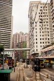 City trams in Hong Kong. HONG KONG, CHINA - MAY 22, 2014: City trams with double deckers and city buildings on may 22, 2014 in Hong Kong Royalty Free Stock Images