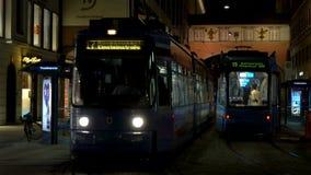 City trams at night Munich, Germany, Europe stock video