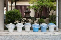 City trash cans. Row of garbage bins are ready to be collected on a residential street royalty free stock photos